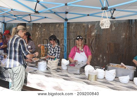 Women Selling Food At Chestnut Festival