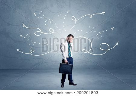 Elegant businessman choosing between directions with winding drawn arrows around