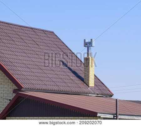 The Roof Of Corrugated Sheet. Brown Corrugated Metal Profile Roo