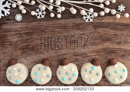 Christmas White Chocolate Ornament Cookies, Double Border On A Wooden Background With Branches And S