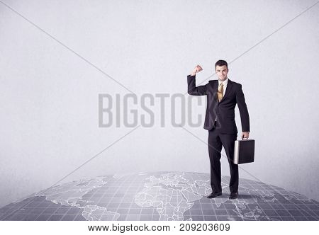 An elegant young male businessman standing on top of the world, pointing up concept with drawn earth map.