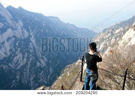Man standing in front of Huashan mountain view in China