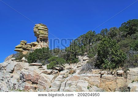 Hoodoo rock formation at Windy Point on Mount Lemmon in Tucson, Arizona, USA in the Santa Catalina Mountains located in the Coronado National Forest with blue sky copy space.