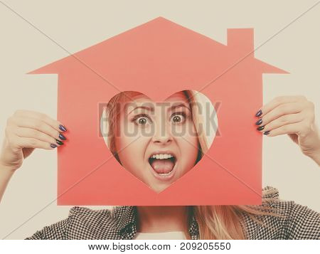 Funny Girl Holding Red Paper House With Heart Shape