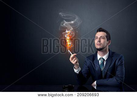 Businessman smoking with inferno effect.