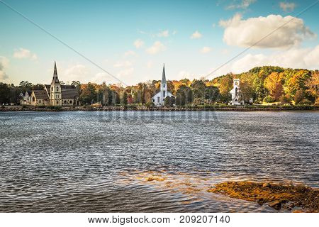 Three churches line the bank of Mahone Bay in Nova scotia Canada.