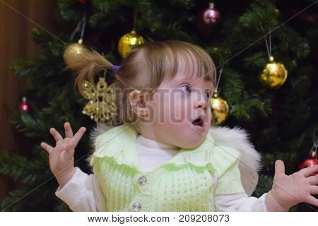 Surprised Girl. Child Mimicry. Girl Throws Up His Hands. One Yea