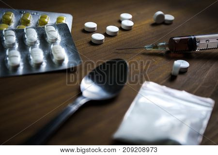Man Substance Dependence Medication Drug Syringe And Cooked Heroin