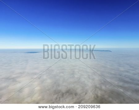 In The Skies Above The Fog. Sunrise Over The Fog. Clouds Near Th