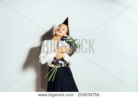 beautiful happy girl with a chic bouquet of chamomiles, isolated, birthday, holiday, joy