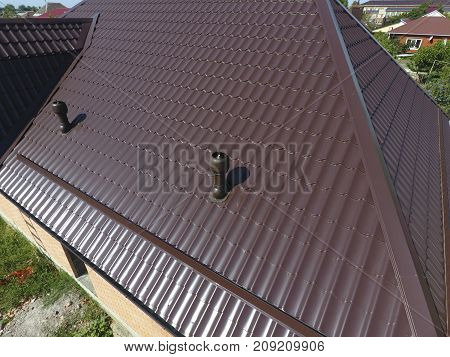 Air Ducts On Metal Roof. The Roof Of Corrugated Sheet. Roofing O