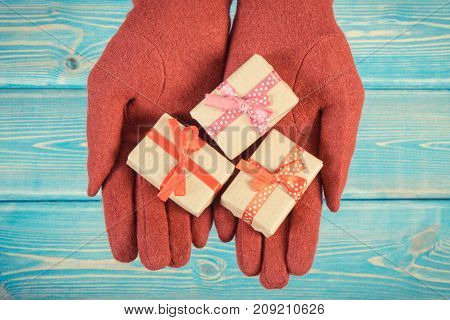 Vintage Photo, Hands Of Woman In Gloves With Gifts For Christmas