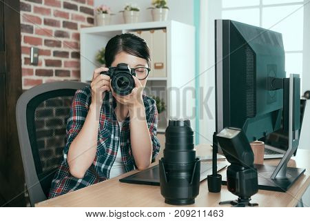 Young Female Student Holding Professional Camera