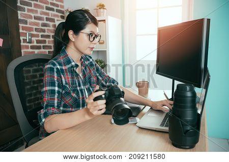 Female Photographer Holding Business Camera
