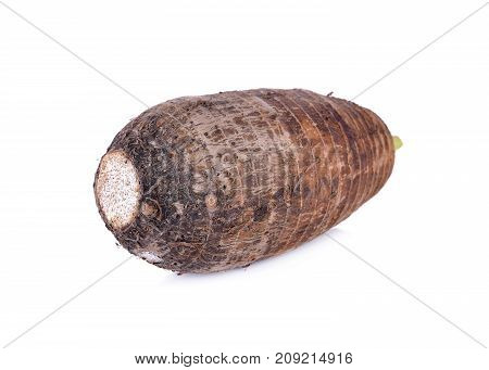 unpeeled raw taro on a white background