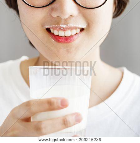 A woman drinking milk