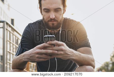 A man playing on his phone