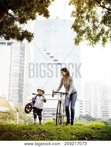 Mother and son cycling in the park