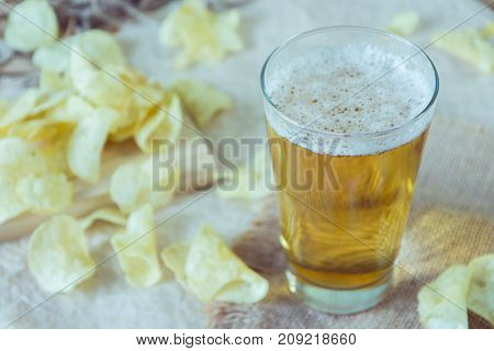 Beer And Chips On The Table. Octoberfest Theme