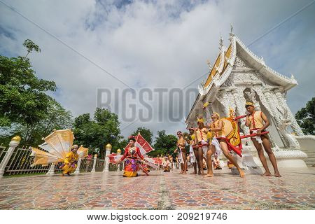 Sukhothai Thailand - August 5 2017: Teenage girls and boys performing northern style dancing to show to tourists in Buddhist temple