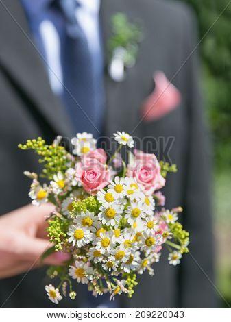Bridal bouquet. Beautiful nosegay in hand of bride