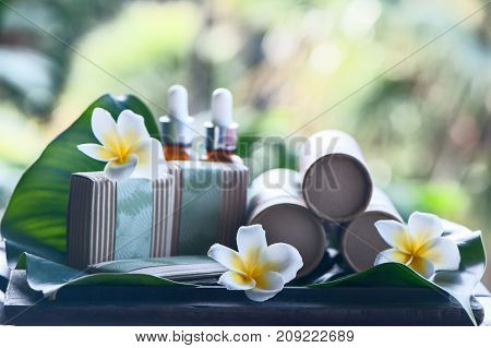 Natural cosmetics on a beautiful tropical background. Mineral, tropical cosmetics. Avocado, scarlet, lotus. Healthy lifestyle