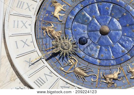 St Mark's Clock tower, astronomical clock on facade, St Mark's Square,Venice, Italy. The clock shows the hours, the seasons, the phases of the moon, the position of the sun in the signs of the zodiac.