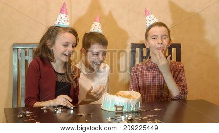 Carefree Children At A Birthday Party. Friends Dunked Face In The Birthday Cake.