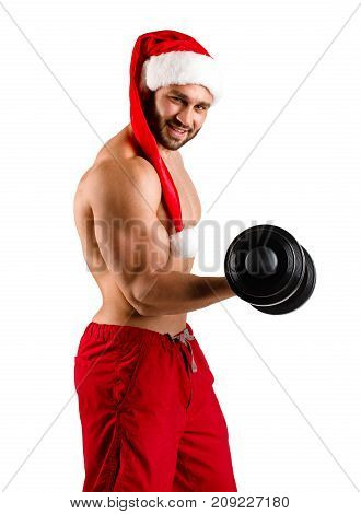 Fitnes christmas santa claus on studio white background, vertical picture. Smile strong man with dumbbells in hand