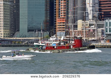 NEW YORK CITY - AUG. 27: boats in the East River on August 27 2017 in New York City NY. The East River is a salt water tidal estuary in New York City.