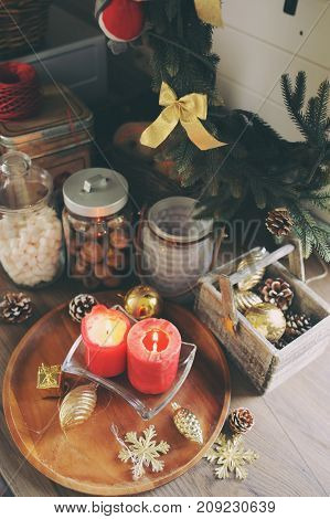 Country house kitchen decorated for Christmas and new year Holidays. Marhmallows candles cocoa and nuts in modern jars. Celebrating at home