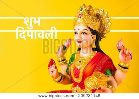 Idol worshipping of Hindu Goddess Lakshmi - Lakshmi Puja is a Hindu religious festival that falls on Amavasya (new moon day) which is  the third day of Tihar or Deepawali