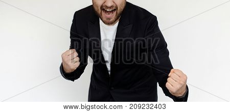 Crop man in suit screaming and celebrating with fists up.