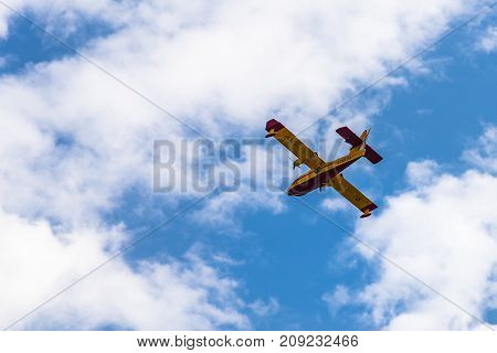 Madrid, Spain - October 12, 2017: Canadair CL-215 T firefighter aircraft against blue and cloudy sky