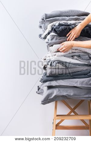 Female Hands Holding Stack Bed Linen Textiles