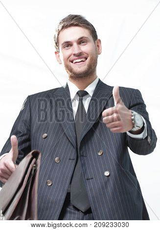 closeup.successful businessman showing thumb up .