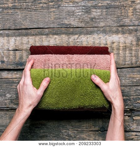 Female Hands Holds Stack Bath Towels Cotton