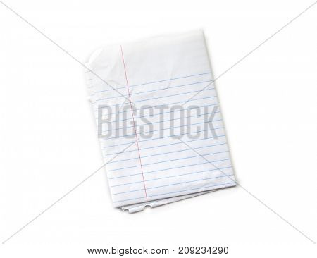 Have been in a bag or pocket for a long time type if folded piece of note pad paper. Isolated on white.