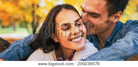 Portrait Of Romantic Young Couple Outdoors In Autumn