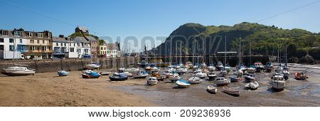 Ilfracombe Devon UK with boats in the harbour on beautiful spring day panoramic view
