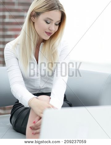 portrait of young business woman sitting in office.