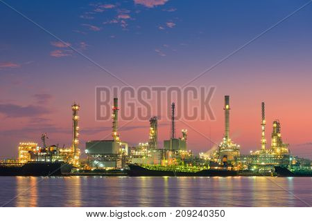 Sunrise scene at oil refinery plant. Logistics and cargo shipping.