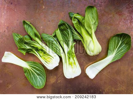 Fresh and raw Chinese cabbage pak choi on vintage background.