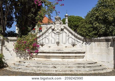 View of the eighteenth century fountain with three spouts and the coat of arms of the Marquis of Pombal in Oeiras Portugal