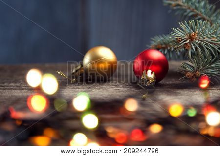 Christmas ornaments on table with a nice festive background Xmas illuminations