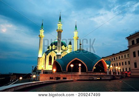 Kazan Russia. Inside Kazan Kremlin Russia. Illuminated Qol Sharif Mosque and other historical buildings during at sunset. Colorful blue cloudy sky