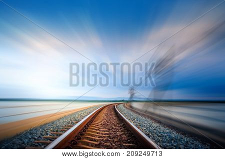 Motion on railroad bridge curve track over the lake Blue Sky