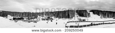 Kopaonik Serbia. Slopes of winter touristic resort in Kopaonik - a largest mountain range in Serbia. It is a national park with beautiful pine forest and ski center. Black and white