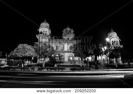 Jaipur India. Illuminated Albert Hall Museum in Jaipur India. Dark sky and car light trails. Black and white