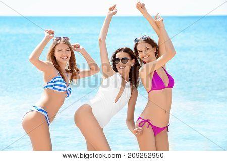 Beautiful young women at sea resort